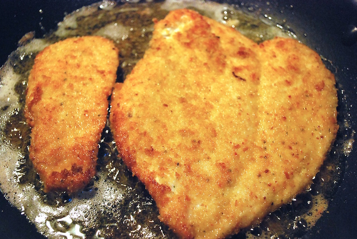 These Italian Chicken Cutlets are coated with Italian breadcrumbs flavored with Parmesan cheese. Delicious on it's own, in a sandwich, or topped with sauce!
