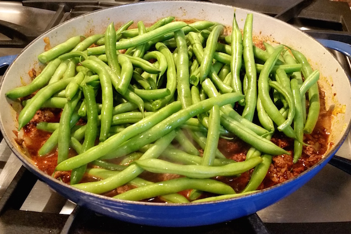 String Beans with Ground Beef - Saltado de Vainitas - is a dish made with string/green beans steamed over deliciously seasoned meat and onions. Simple to prepare and makes a fantastic meal anytime of the week.