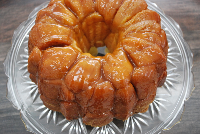 Baked homemade monkey bread on a cake platter ready to eat.