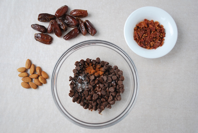 Chocolate Dates Bacon, and the result is a delicious concoction of a date, stuffed with an almond, then coated with spiced chocolate mixed with bacon bits. The combination of textures and flavors will tantalize your tastebuds and put a smile on your face.