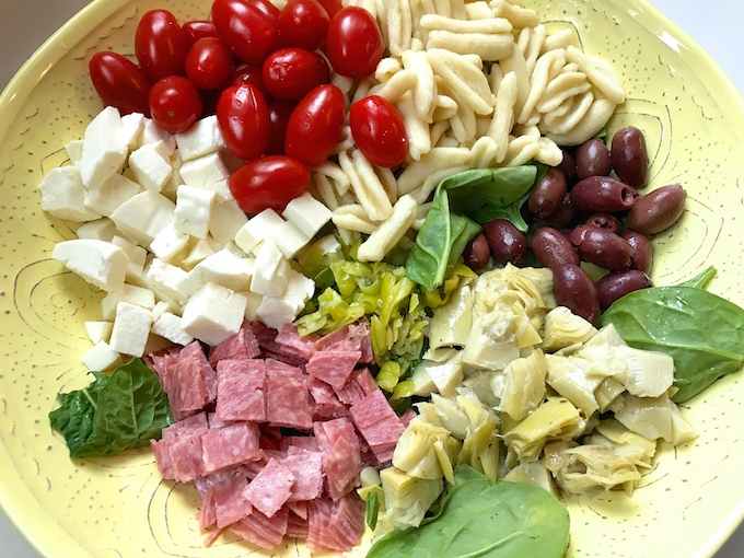 This easy Antipasto Pasta Salad is loaded with flavor offering different textures along with several variations of acidity which brightens the dish along with the palate. Paired with my simple vinaigrette, it's a hearty salad that's a meal in itself.