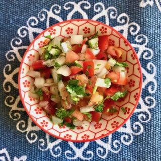 Pico de Gallo - a delicious mix of diced tomatoes, onions, jalapeño, cilantro, and lime - can brighten any dish or eaten simply piled high on a corn chip.