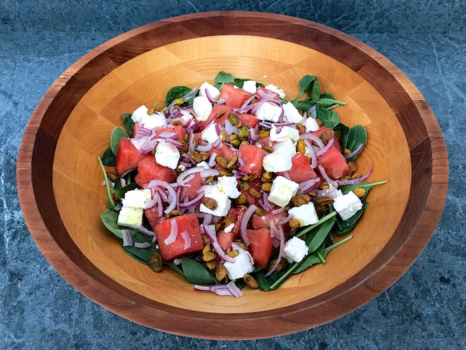 Spinach Watermelon Feta Salad with Lime Vinaigrette - Baby spinach flavored with the juices of fresh cubed watermelon, creamy chunks of feta cheese, sweet sliced red onion, and salted roasted pistachios, all drizzled with a delicious lime vinaigrette.