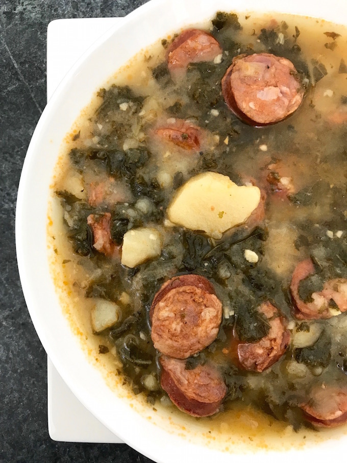 Closeup of a bowl of Linguisa Kale Soup (Caldo Verde).