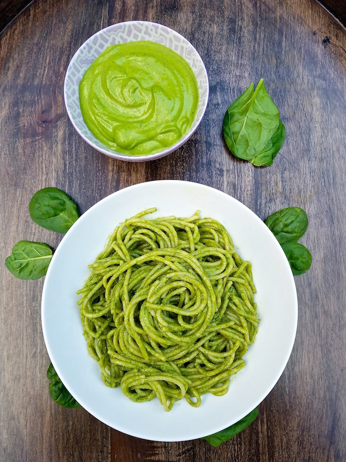 Plate of spinach pesto and bowl of pesto sauce.