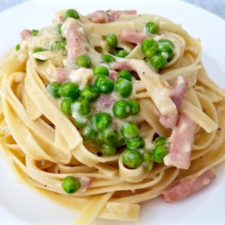 Closeup of Creamy Fettuccine with Peas and Ham