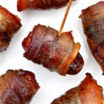 Dates wrapped in bacon with almonds.